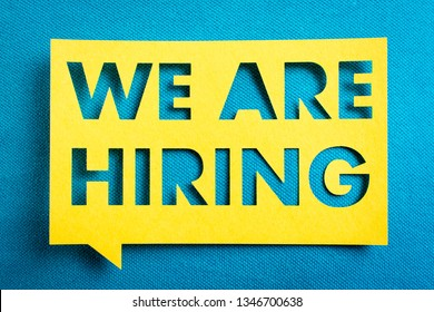 """Concept of recruitment and job search. """"We are hiring"""" yellow banner on blue textured background. Job board design, template."""