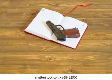 The concept of a red book and a gun, the problem of weapons in schools