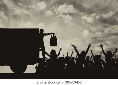 Concept of the refugees. Silhouette of humanitarian assistance to the refugees against the evening sky