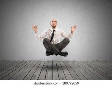 Concept of relax with businessman doing yoga
