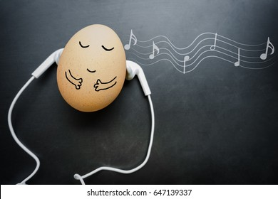 concept relaxed style in the morning with egg sleep and earphone on the blackboard and note. musical mood induction background. music style