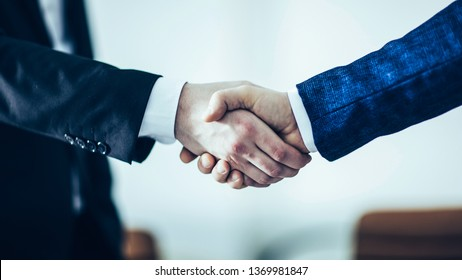 concept of a reliable partnership : a handshake of business par