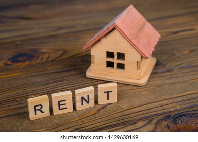 Concept rental house. Wooden house and text on the cubes Rent.
