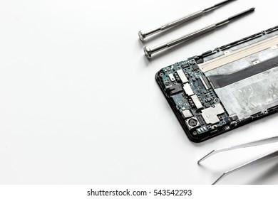 concept repair smartphone - parts of digital gadgets with tools