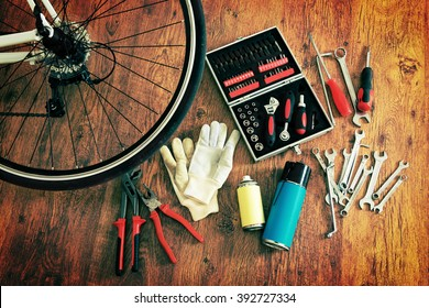 Concept of repairing or maintenance bike with tools and bottles