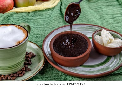 Concept: restaurant menus, healthy eating, homemade, gourmands, gluttony. Ceramic plate with chocolate souffle and ice cream on a messy vintage wooden background.