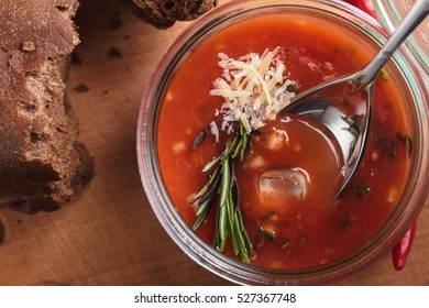 Concept: restaurant menus, healthy eating, homemade, gourmands, gluttony. Gazpacho in a glass bowl on a messy wooden background.