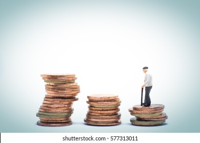 Concept of retirement planning. Old man standing on stack step of coin.
