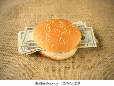 Concept for rich and greedy - Burger buns stuffed with money