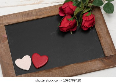 a concept romantic, small chalkboard, roses and heart
