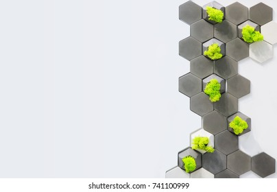 Concept of the room, design of the wall, white and gray concrete bricks and moss growing in them. Ecological office decor, white background with place for text.