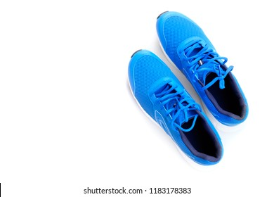 Concept run. Concept love run. Blue running shoes for men on a white background. Top view