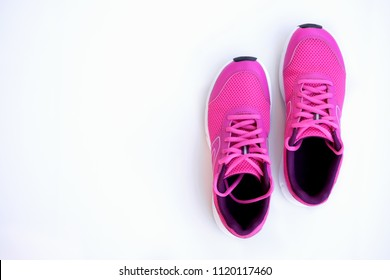 Concept run. Pink running shoes for women on a white background. Top view