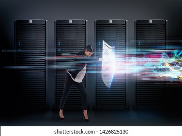 Concept of safety in a data center room with database server. Woman with shield defends against hacker attacks