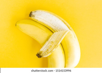 Concept of same-sex LGBT love, two bananas hugging on a yellow pastel background