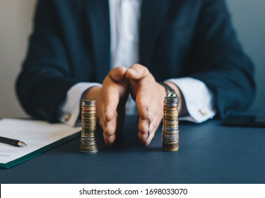 Concept of  saving and investing. Businessman separates stack coins. Property division. Divorce and legal services.
