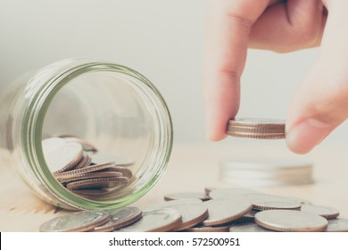 Concept saving money business finance for investment, Coins in glass and hand putting money