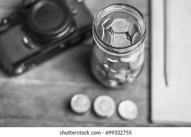 Concept of saving money by collecting coins in a glass jar. Money Thailand.