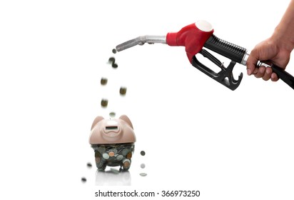 Concept of saving money Hand holding fuel nozzle pouring Thai coins on white background