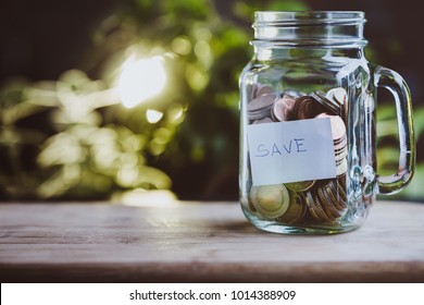 Concept of saving money in a jar.