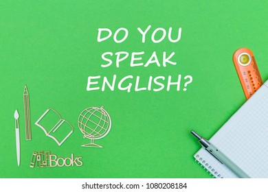 concept school, text do you speak english, school supplies, notebook, ruler and pen on green backboard