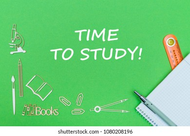 concept school, text time to study, school supplies wooden miniatures, notebook with ruler and pen on green backbord