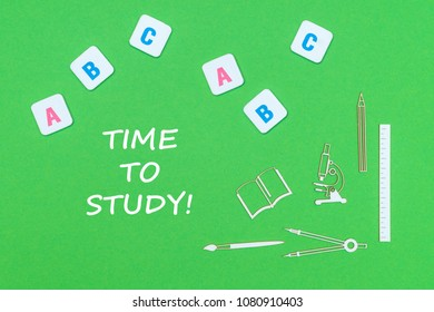 concept school, text time to study, school supplies wooden minitures, abc letters on green backboard
