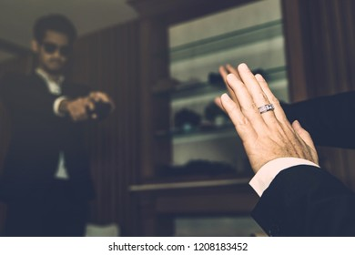 Concept, science : The gunman manages to raise a shotgun to kill traitors and disrupt business interests, where victims are raising their hands for life.