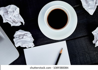 Concept in search ideas. Creased paper of idea. cup of coffeee with notebook and pen . Still life, business, office supplies or education concept. Flat lay. Top view.  Exam, school, student