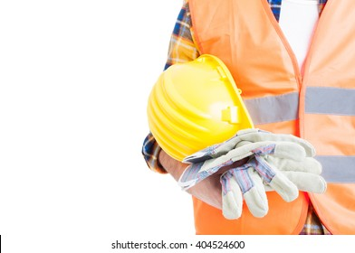 Concept of secure equipment with helmet, reflective vest and gloves in close-up isolated on white