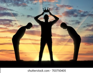 Concept of selfishness and narcissistic. Silhouette of a selfish man dresses his crown, and servants bow to him