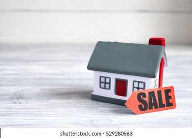 concept of selling home on wooden background