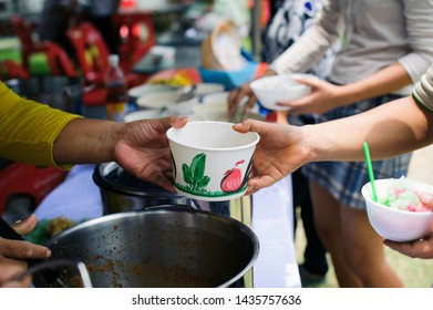 Concept serving free food to the poor : Free food, Using leftovers to feed the hungry : Food concept of hope : Food donation in the poor community of volunteers