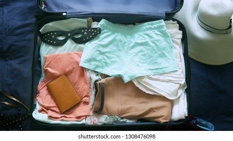 The concept of sex tourism. close-up, a woman collects a suitcase and puts into it the BDSM device.