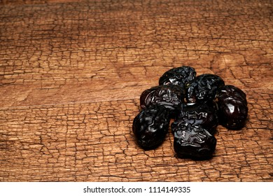 Concept shot of Ajwa dates for breaking fast during the holy month of Ramadan. Ajwa dates is favoured by Prophet Muhammad SAW.