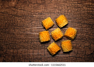 Concept shot of a group of pineapple roll tarts isolated on wooden textured background.  A local favorite for Eid in Malaysia.