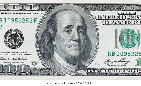 Concept showing devaluation of american dollars by Quantitative easing program - crying Benjamin Franklin
