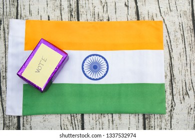 Concept of showing a Gift for vote,Gift box with vote sticker on Indian flag.