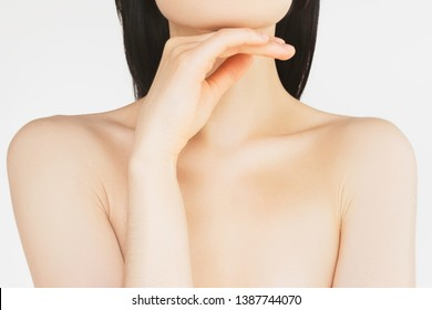 concept of skin care and cosmetology. young thin woman takes care of the skin of the body, touches the skin on the neck and shoulders, after moisturizing and rejuvenation procedures and hair removal