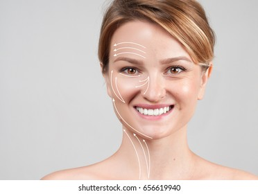 Concept of skin rejuvenation. Face lift anti-aging treatment - woman with massage lines showing facial lifting effect on skin