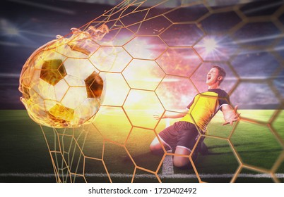 concept - soccer ball on the net and euphoric soccer player