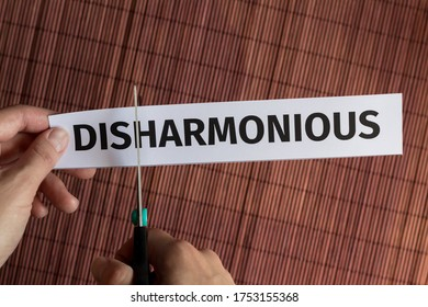 Concept solution to the problem: the word disharmony is cut with scissors to get the word harmony