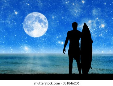 Concept of sport. Silhouette of surfer at night on the background of the sea