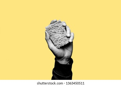 Concept of staying clean from alcohol and drugs. Stay sober. Hand holding a cleaning sponge in black and white. Yellow background
