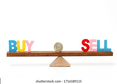 Concept for stock market-Buy and sell words balancing on seesaw