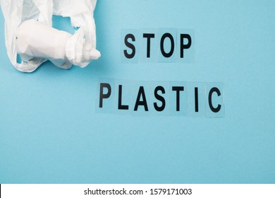 Concept of stop plastic pollution, global warming, recycling plastic, plastic free. White bear,plastic bag on blue background