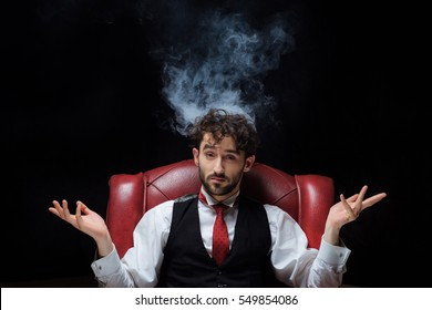 Concept of stress with businessman and smoke in head