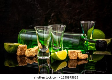 the concept of strong alcohol. Absinthe with a sugar cubes, lime slices. absinthe. space for text.