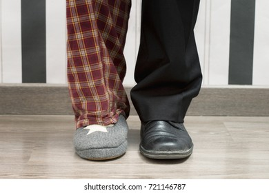Concept of success and failure. Foot of an executive man and idl man in bedroom slipper.Horizontal shot. Studio shot.