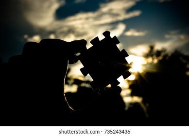 The concept of success jigsaw on sky and sun light
